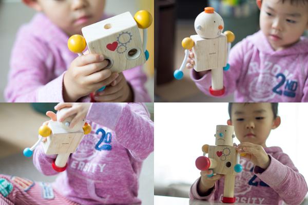 ビルドロボットを組み立てている子供
